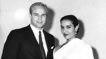 Marlon Brando, left, with his fiancee Anna Kashfi, the day before their wedding in October 1957